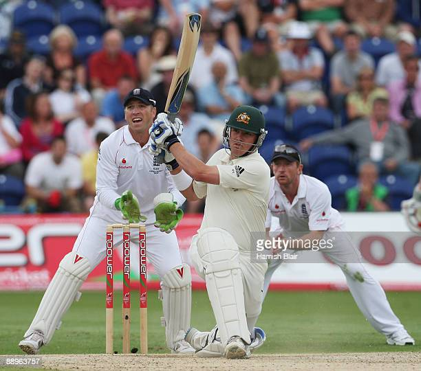 Marcus North of Australia hits out watched by Matt Prior and Paul Collingwood of England during day three of the npower 1st Ashes Test Match between...