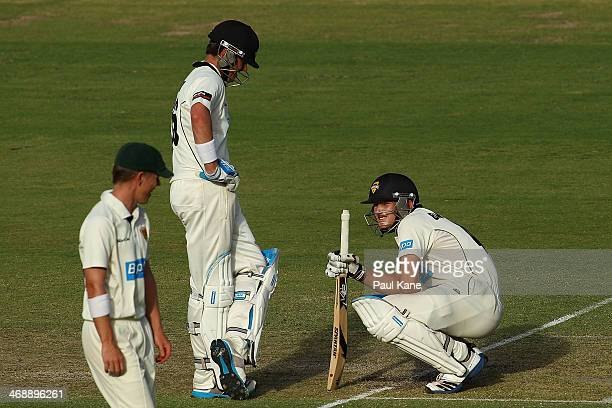 Marcus North of the Warriors looks on as Cameron Bancroft crouches at the crease after being struck in the groin during day one of the Sheffield...