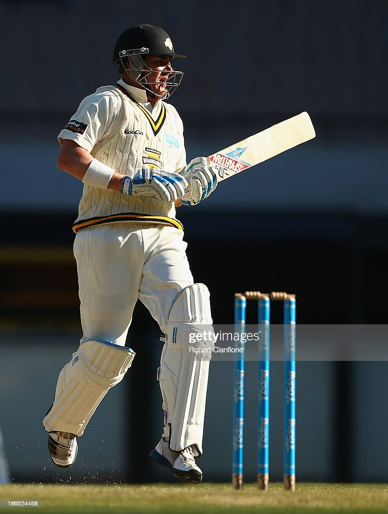 Marcus North of the Warriors makes a run during day three of the Sheffield Shield match between the Victoria Bushrangers and the Western Australia Warriors at Melbourne Cricket Ground on November 1, 2013 in Melbourne, Australia.