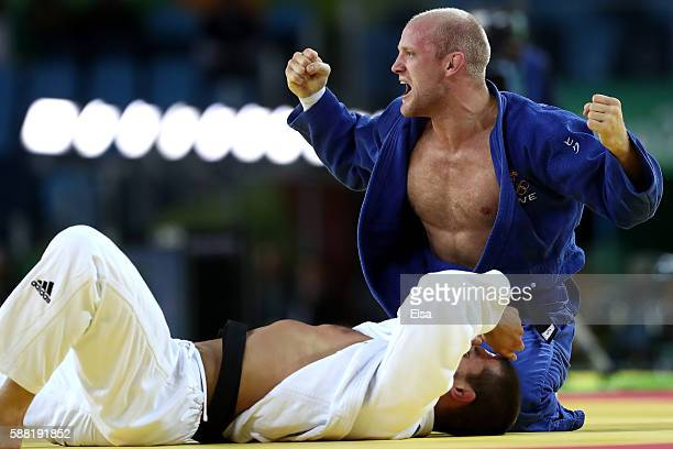 Marcus Nyman of Sweden celebrates against Alexandre Iddir of France during a Men's 90kg Repechage bout on Day 5 of the Rio 2016 Olympic Games at...