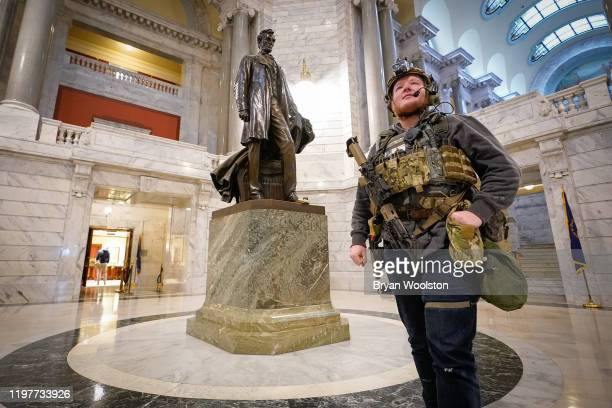 Marcus Olmstead stands in the rotunda of the State Capitol carrying a semiautomatic firearm on January 31 2020 in Frankfort Kentucky Open carry of...