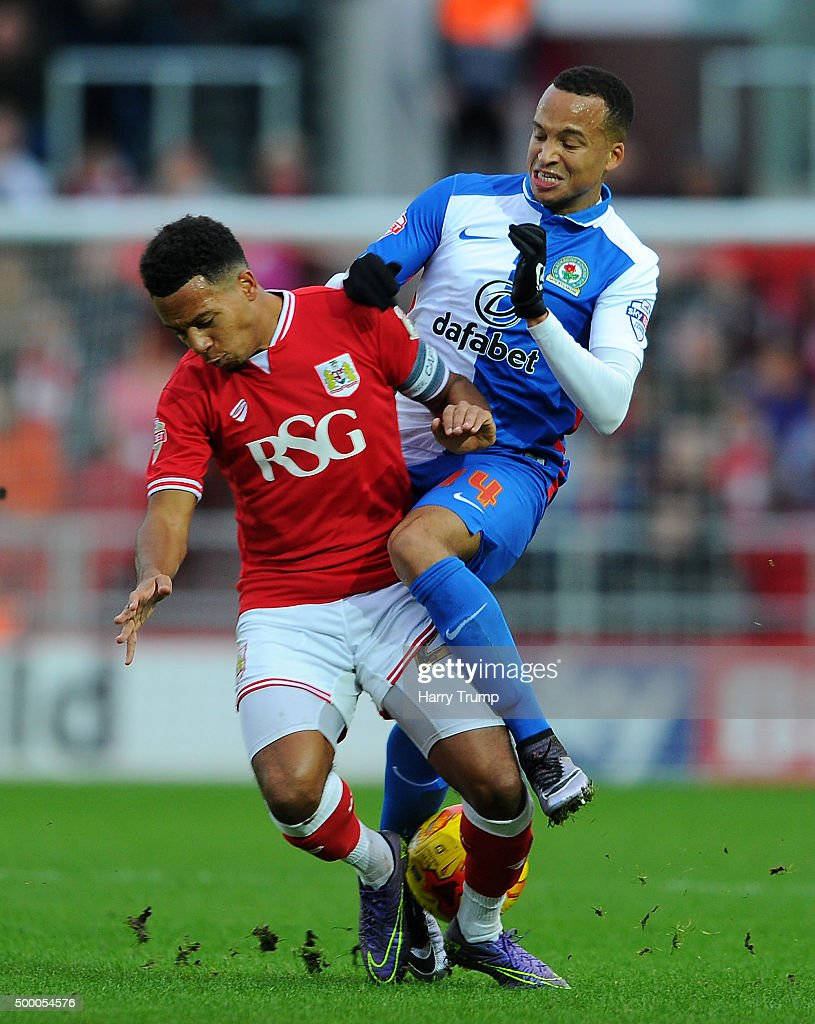 Marcus Olsson of Blackburn Rovers is tackled by Korey Smith of Bristol City during the Sky Bet Championship match between Bristol City and Blackburn Rovers at Ashton Gate on December 5, 2015 in Bristol, England.