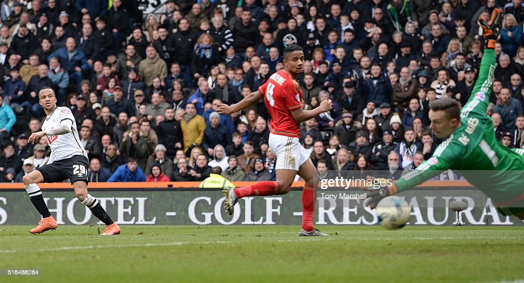 Marcus Olsson (L) of Derby County scores his team's first goal past Dorus de Vries (R) of Nottingham Forest during the Sky Bet Championship match between Derby County and Nottingham Forest at the iPro Stadium on March 19, 2016 in Derby, United Kingdom.