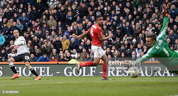 Marcus Olsson of Derby County scores his team's first goal past Dorus de Vries of Nottingham Forest during the Sky Bet Championship match between...