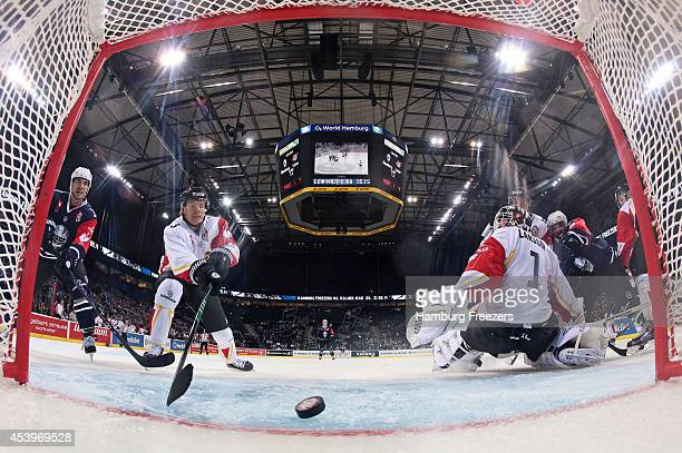 Marcus Oskarsson #03 of Lulea saves a goal during the Champions Hockey League group stage game between Hamburg Freezers and Lulea Hockey on August 22...