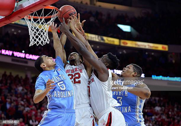Marcus Paige and Kennedy Meeks of the North Carolina Tar Heels battle for a rebound with Ralston Turner and AbdulMalik Abu of the North Carolina...
