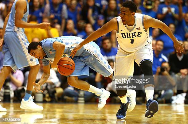 Marcus Paige of the North Carolina Tar Heels and Jabari Parker of the Duke Blue Devils go after a loose ball during their game at Cameron Indoor...