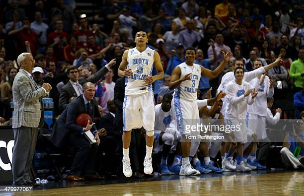 Marcus Paige of the North Carolina Tar Heels celebrates during the closing seconds of the Tar Heels 7977 win over the Providence Friars during the...
