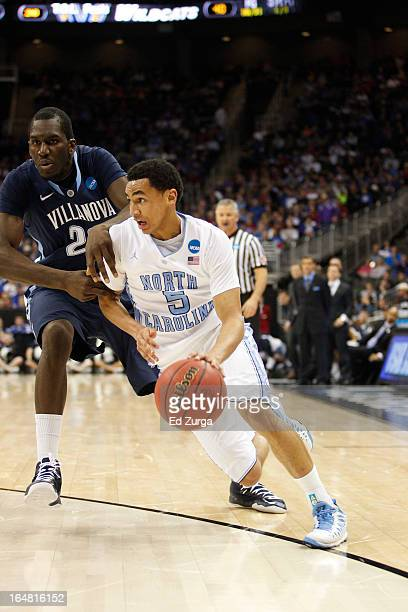 Marcus Paige of the North Carolina Tar Heels drives against Achraf Yacoubou of the Villanova Wildcats during the second round of the 2013 NCAA Men's...