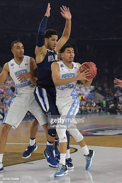 Marcus Paige of the North Carolina Tar Heels drives against Josh Hart of the Villanova Wildcats during the 2016 NCAA Men's Final Four Championship at...