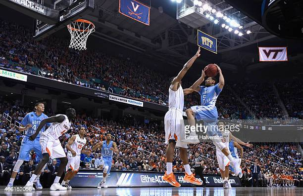 Marcus Paige of the North Carolina Tar Heels drives to the basket against the Virginia Cavaliers during the semifinals of the 2015 ACC Basketball...