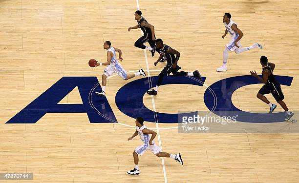 Marcus Paige of the North Carolina Tar Heels goes down the court against the Pittsburgh Panthers during the quarterfinals of the 2014 Men's ACC...
