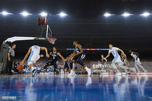 Marcus Paige of the North Carolina Tar Heels moves the ball against Josh Hart of the Villanova Wildcats during the 2016 NCAA Men's Final Four...