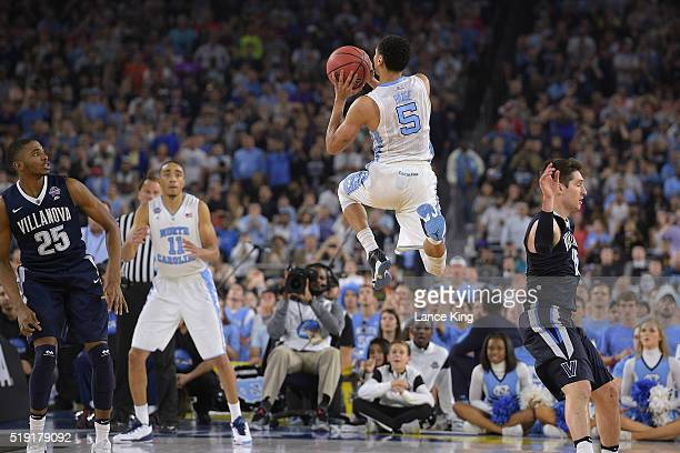 Marcus Paige of the North Carolina Tar Heels puts up a threepoint shot to tie the score at 7474 with 47 seconds left in the game against the...