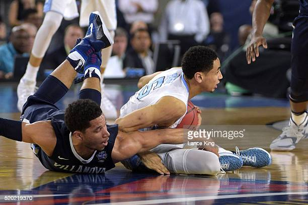 Marcus Paige of the North Carolina Tar Heels regains control of the ball against Josh Hart of the Villanova Wildcats during the 2016 NCAA Men's Final...