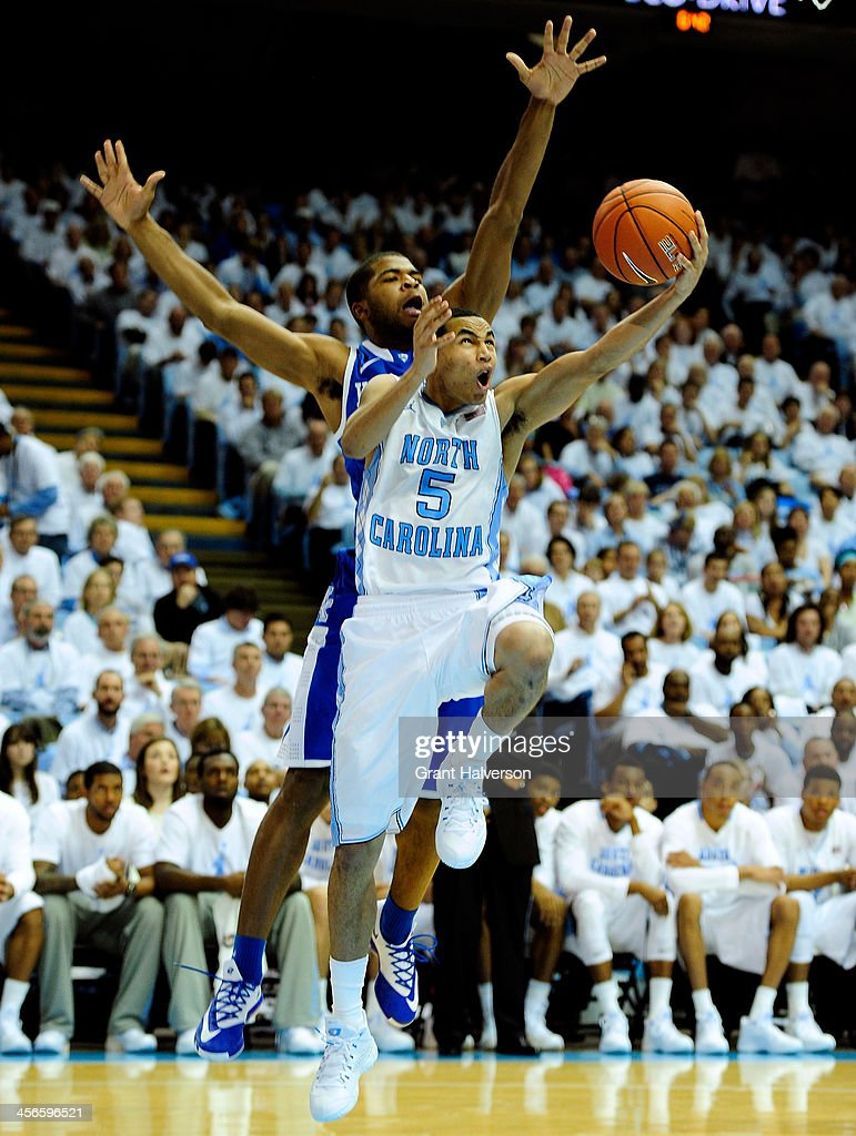 Marcus Paige #5 of the North Carolina Tar Heels scores against Dominique Hawkins #25 of the Kentucky Wildcats during play at the Dean Smith Center on December 14, 2013 in Chapel Hill, North Carolina. North Carolina won 82-77.