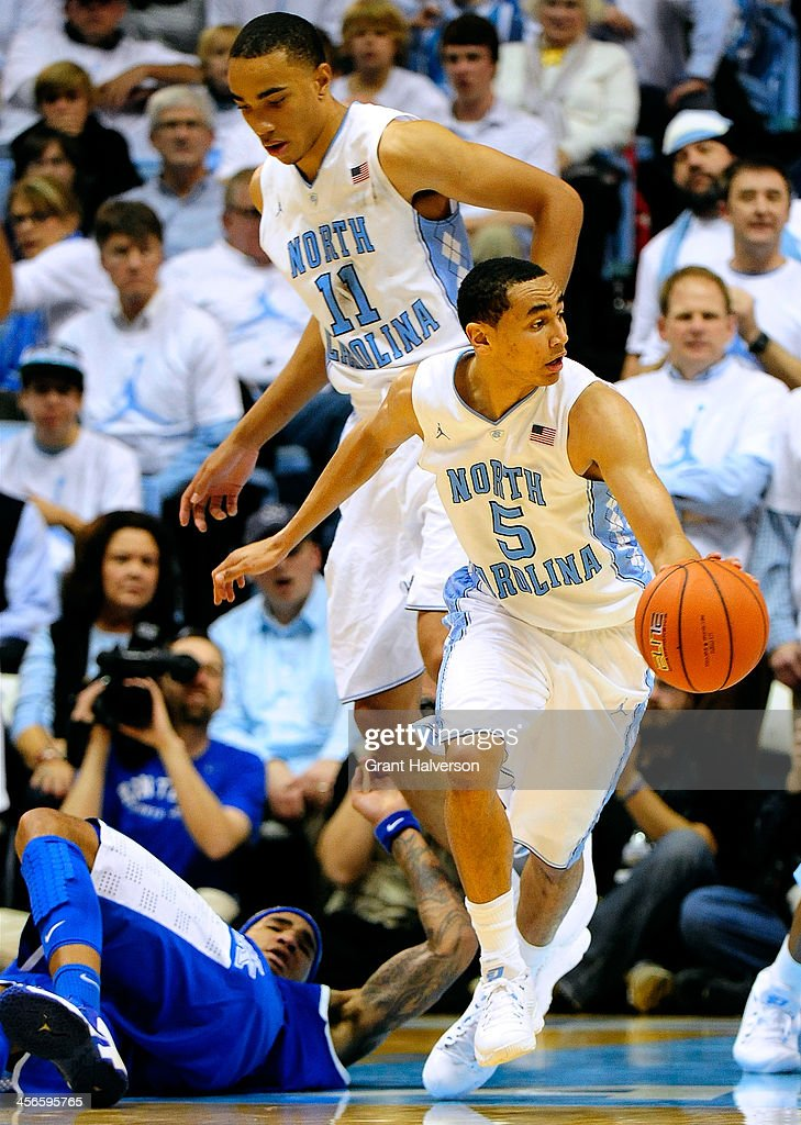 Marcus Paige #5 of the North Carolina Tar Heels takes a loose ball away from Willie Cauley-Stein #15 of the Kentucky Wildcats during play at the Dean Smith Center on December 14, 2013 in Chapel Hill, North Carolina. North Carolina won 82-77.