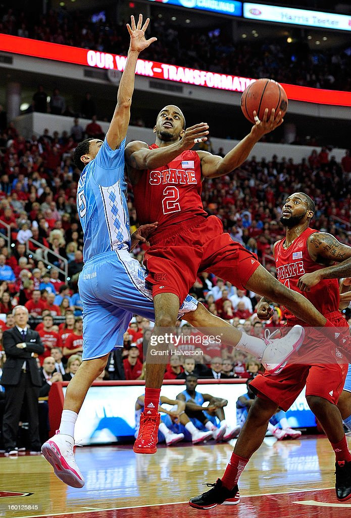 Marcus Paige #5 of the North Carolina Tar of defends a drive by Lorenzo Brown #2 of the North Carolina State Wolfpack during play at PNC Arena on January 26, 2013 in Raleigh, North Carolina.