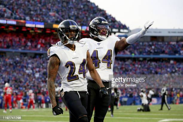 Marcus Peters and teammate Marlon Humphrey of the Baltimore Ravens react after breaking up a pass during the fourth quarter of an NFL game against...