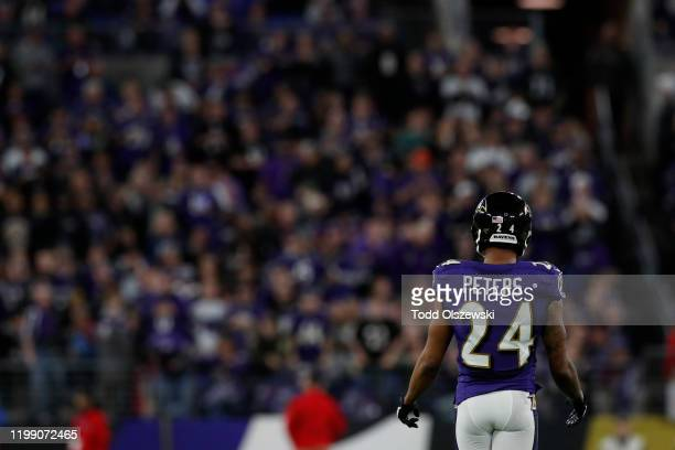 Marcus Peters of the Baltimore Ravens stands on the field during the first quarter of the AFC Divisional Playoff game against the Tennessee Titans at...