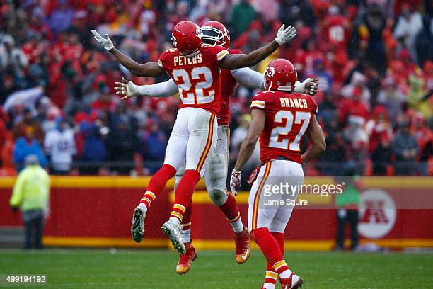Marcus Peters of the Kansas City Chiefs celebrates with teammate Tamba Hali of the Kansas City Chiefs after a defensive stop at Arrowhead Stadium...