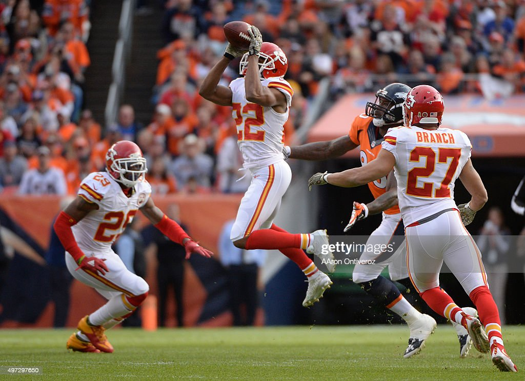 Marcus Peters (22) of the Kansas City Chiefs intercepts Peyton Manning's first pass attempt in the first quarter. The Broncos played the Kansas City Chiefs at Sports Authority Field at Mile High in Denver, CO on November 15, 2015.
