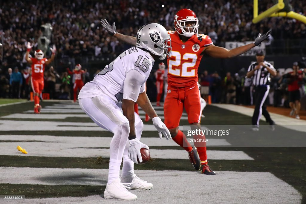 Marcus Peters #22 of the Kansas City Chiefs reacts after a pass interference call in the endzone against Michael Crabtree #15 of the Oakland Raiders during their NFL game at Oakland-Alameda County Coliseum on October 19, 2017 in Oakland, California.