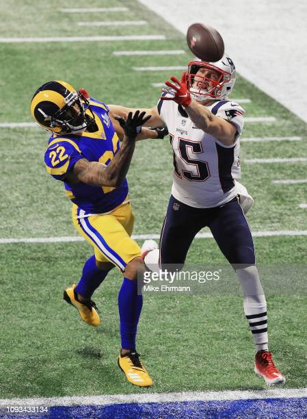 Marcus Peters of the Los Angeles Rams defends a pass against Chris Hogan of the New England Patriots in the first half of the Super Bowl LIII at...