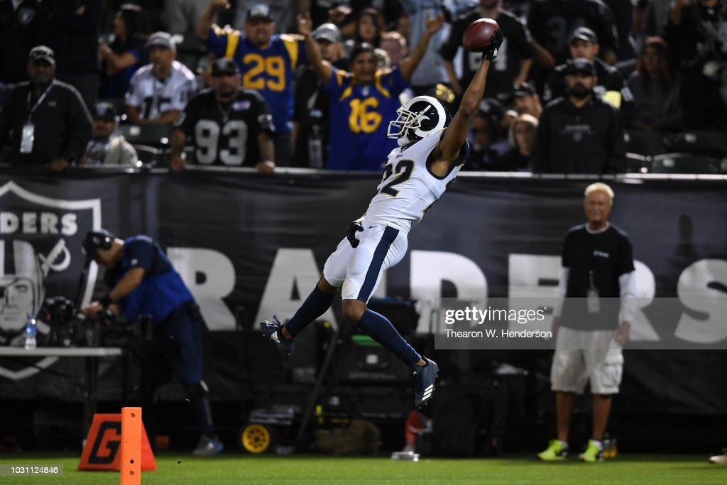 Marcus Peters #22 of the Los Angeles Rams dives into the endzone after an interception of Derek Carr #4 of the Oakland Raiders in the fourth quarter of their NFL game at Oakland-Alameda County Coliseum on September 10, 2018 in Oakland, California.