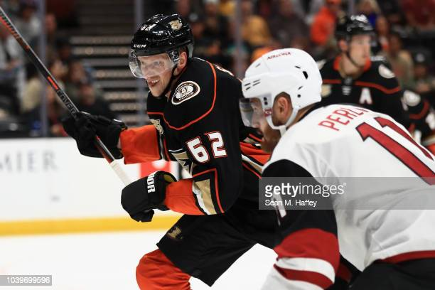 Marcus Pettersson of the Anaheim Ducks skates past Brendan Perlini of the Arizona Coyotes during the second period of an NHL preseason game at Honda...
