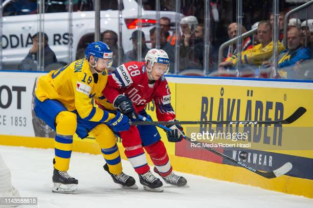 Marcus Pettersson vies with Niklas Roest during the 2019 IIHF Ice Hockey World Championship Slovakia group game between Norway and Sweden at Ondrej...