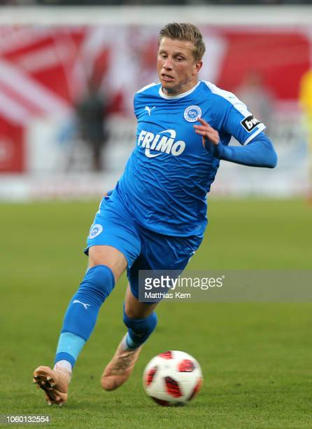 Marcus Piossek of Lotte runs with the ball during the 3. Liga match between FC Energie Cottbus and VfL Sportfreunde Lotte at Stadion der Freundschaft...