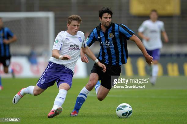 Marcus Piossek of Osnabrueck and Tim Kruse of Saarbruecken battle for the ball during the 3 Liga match between 1 FC Saarbruecken and VfL Osnabrueck...