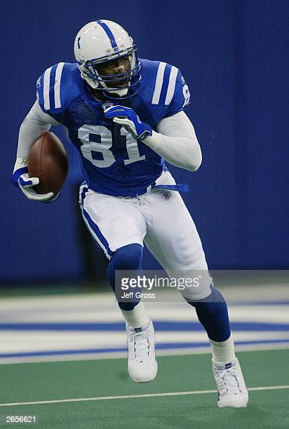 Marcus Pollard of the Indianapolis Colts carries the ball during their game against the Houston Texans on October 26 2003 at the RCA Dome in...