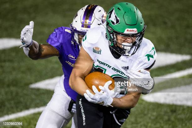 May 02: Marcus Preston of the North Dakota Fighting Hawks carries the ball against Que Reid of the James Madison Dukes during the second half of the...