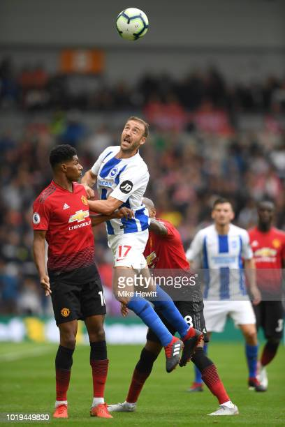 Marcus Rashford and Ashley Young of Manchester United battle for the header with Glenn Murray of Brighton and Hove Albion during the Premier League...