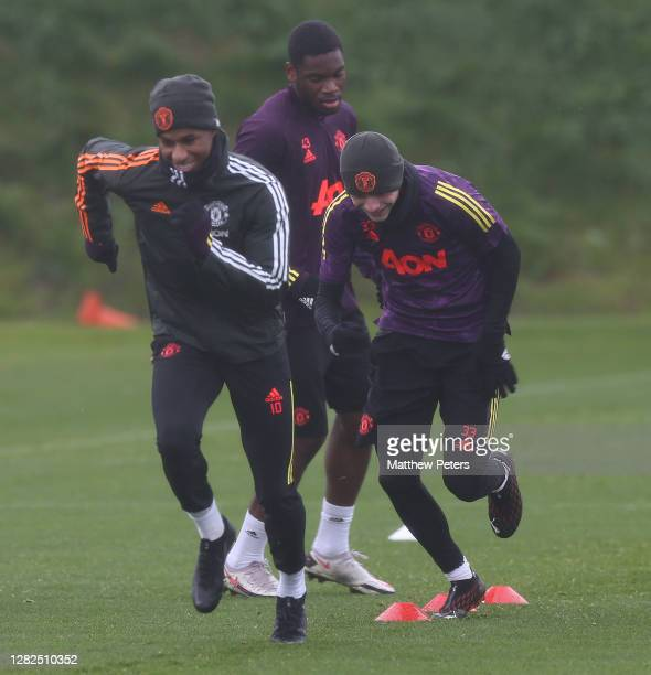Marcus Rashford and Brandon Williams of Manchester United in action during a first team training session ahead of the UEFA Champions League Group H...