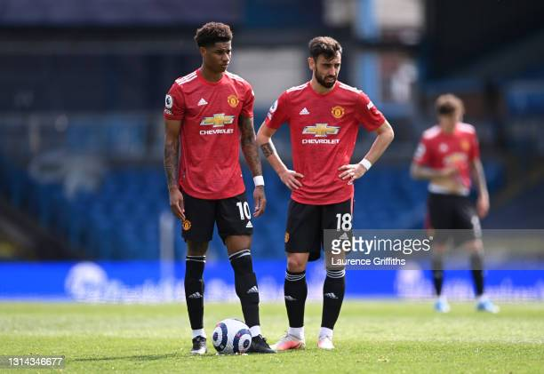 Marcus Rashford and Bruno Fernandes of Manchester United stand over a free kick during the Premier League match between Leeds United and Manchester...