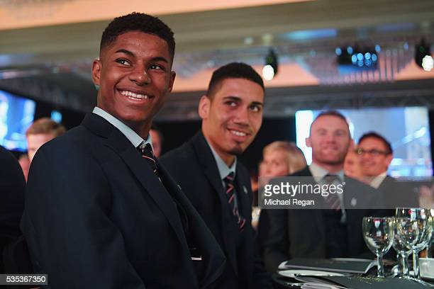 Marcus Rashford and Chris Smalling look on during the England Footballers Foundation charity event at Sopwell House on May 29 2016 in St Albans...