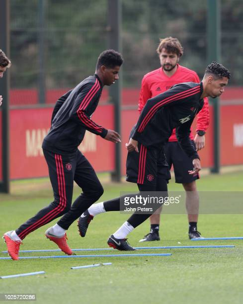 Marcus Rashford and Chris Smalling of Manchester United in action during a first team training session at Aon Training Complex on September 1 2018 in...