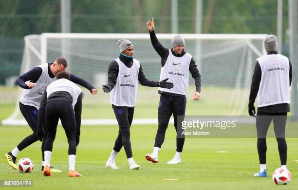 Marcus Rashford and Eric Dier gesture during an England training session at Spartak Zelenogorsk Stadium on July 6 2018 in Saint Petersburg Russia
