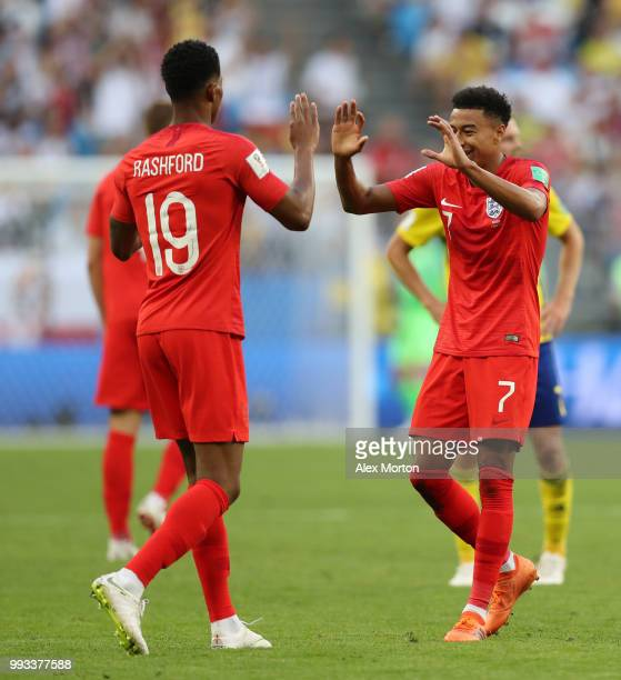 Marcus Rashford and Jesse Lingard of England celebrate following their sides victory in the 2018 FIFA World Cup Russia Quarter Final match between...