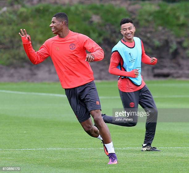Marcus Rashford and Jesse Lingard of Manchester United smile during a Manchester United Training session at Aon Training Complex on September 28 2016...