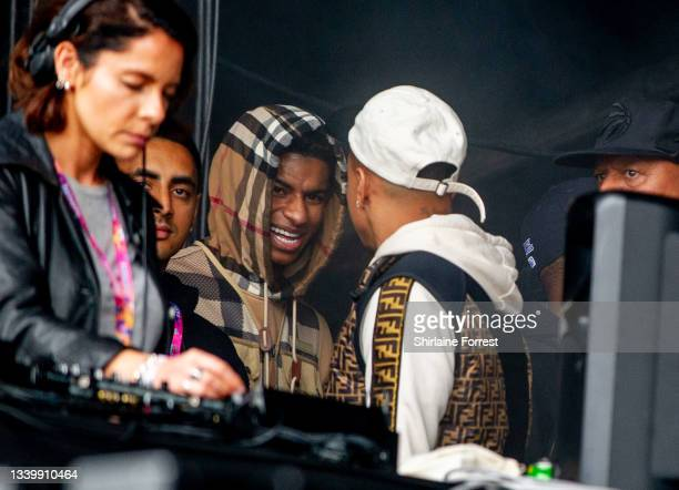 Marcus Rashford and Jesse Lingard watch Migos perform during Parklife at Heaton Park on September 12, 2021 in Manchester, England.