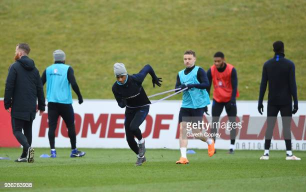 Marcus Rashford and Kieran Trippier perform a drill during an England training session on the eve of their international friendly against the...