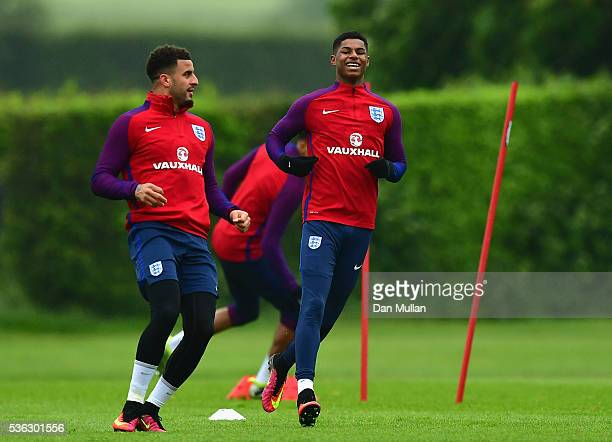 Marcus Rashford and Kyle Walker in action during an England training session at London Colney on June 1 2016 in St Albans England