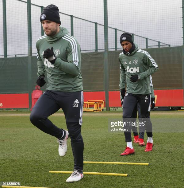 Marcus Rashford and Luke Shaw of Manchester United in action during a first team training session at Aon Training Complex on January 28 2018 in...