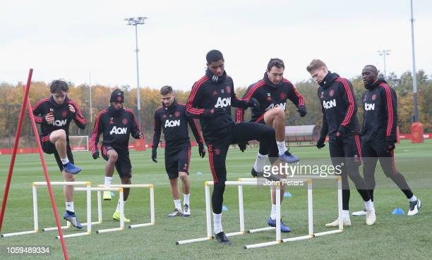 Marcus Rashford and Matteo Darmian of Manchester United in action during a first team training session at Aon Training Complex on November 9 2018 in...