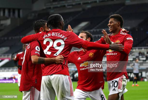 Marcus Rashford and team mates congratulate Bruno Fernandes on scoring his sides second goal during the Premier League match between Newcastle United...