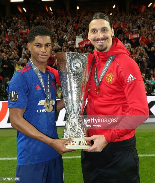 Marcus Rashford and Zlatan Ibrahimovic of Manchester United celebrate with the Europa League trophy after the UEFA Europa League Final match between...